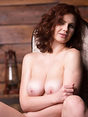Aphrodita sensually poses on the chair as she flaunts her..