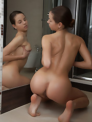 Antea poses by the mirror baring her petite body and..