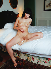 Malena slips her hand inside her panties to tease her pussy