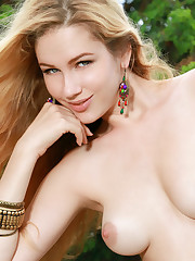 Gorgeous Genevieve Gandi displays her delectable tits and..