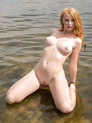 Helene bares her delectable body outdoors as she dips in..