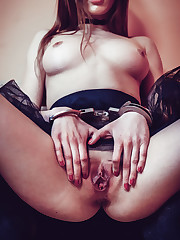 Marlyn flaunts her handcuffs as she plays with her pussy.