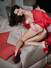 Dita V takes off her red silk robe and matching lingerie..