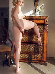 Voluptous Kery teases in panties and high heels