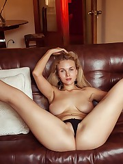 Blonde bombshell Caroline Abel in highly provocative poses..