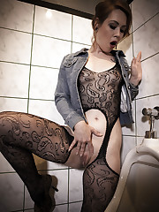 Foxy Sanie plays with her pussy as she piss in the men's..