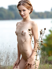 Yayna flaunts her petite body and small tits outdoors.