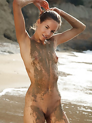 Antea bares her wet, sandy body at the beach.