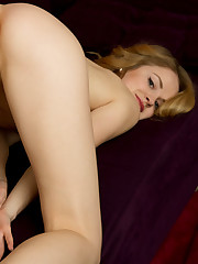 Alice May spread her legs wide open as she bares her..