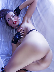Gagged Noelia flaunts her tight body and smooth pussy.