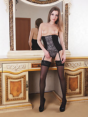 Giulia strips her sexy, black corset with matching stockings as..