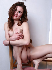 Flora D flaunts her naked body and meaty pussy on the bed.