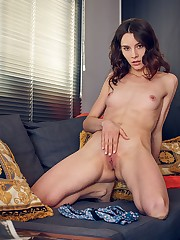Adel Morel relaxes in the couch before masturbating her..