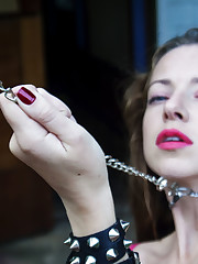 Mika A teasing and seducing in hot pink lingerie and chains
