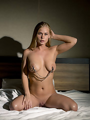 Sarika A shows off her delectable, erotic body on the bed.