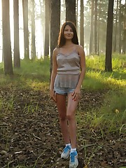 Melisia gets naked in the woods and shows off her breasts..