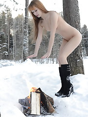Alma flaunts her naked body as she makes fire in the snow.