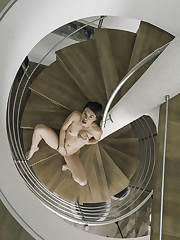 Tiffany Doll poses at the stairs as she bares her lusty..