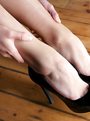 Satisfying close up photos of bare, slender feet, perky..