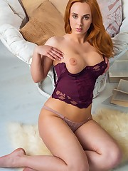 Vos poses in her plum-colored lingerie before stripping..