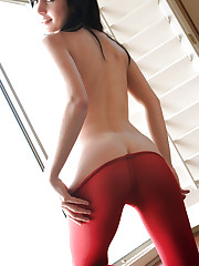 Catie Minx pulls down her sexy red tights over her tight..