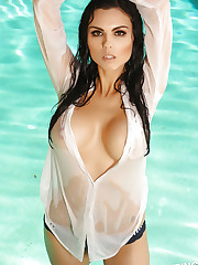 Busty Alluring Vixen Krystle Lina shows off her massive..