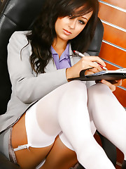 Beautiful brunette secretary Laura A strips from her cute..