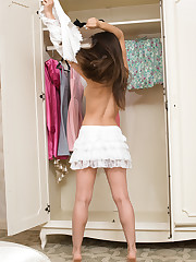 Slava A displays her gorgeous physique inside the closet.