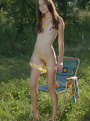 New model Rimma B strips outdoors as she flaunts her perky..