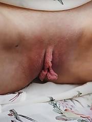 Kira takes off her top and panties and starts masturbating..