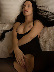 Black-haired seductress Veronica Snezna spreads her legs..