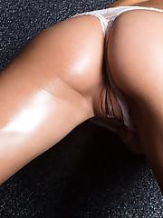 Sandra Lauver sprawls in the wet floor as she strokes her..