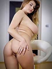 Lucy Li takes off her clothes and masturbates in the..