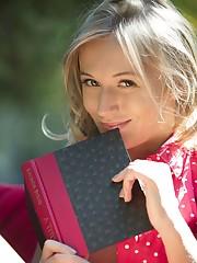 Sandra Shine enjoys reading outdoors before masturbating..