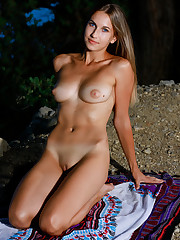 Newcomer Milenia strips outdoors baring her sexy, slender..