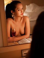 Sintia posig seductively for the camera as she enjoys a..