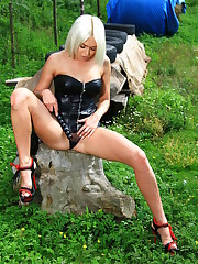 Lena Love spreads her legs as she inserts the whip handle..