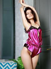 Brunuette cutie Megan Elle starts her day by stripping her..