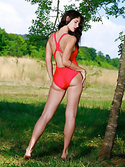 Yasmina strips her sexy red bikini outdoors as she bares..