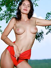 Yasmina strips her sexy red bikini outdoors as she bares..