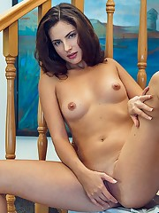 Jasmine Jazz performs a slow and sensual striptease by the..