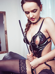 Maria Z shows off her dark side with shiny leather suit..