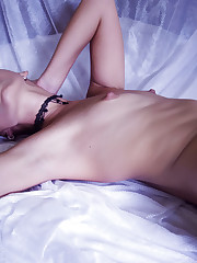 Noelia sexily plays with a flogger