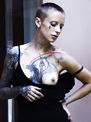 Sasha Beart flaunts her lusty, tattooed body and creamy..