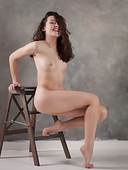 New model Ulia bares her slender, naked body and trimmed pussy..