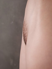 New model Ulia bares her slender, naked body and trimmed..