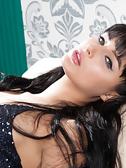 Yarina A strips on the couch as she bares her smoking hot..
