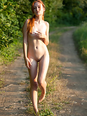 New model May poses on the road as she bares her..