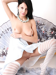 Denara displays her smooth pussy as she bares her sexy..