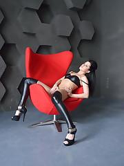 Olia masturbates her sweet pussy on the chair.